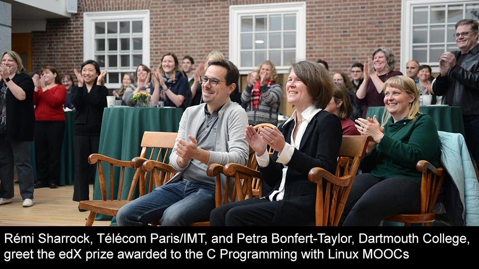 Rémi Sharrock, Télécom Paris/IMT, and Petra Bonfert-Taylor, Dartmouth College, greet the edX prize awarded to the C Programming with Linux MOOCs