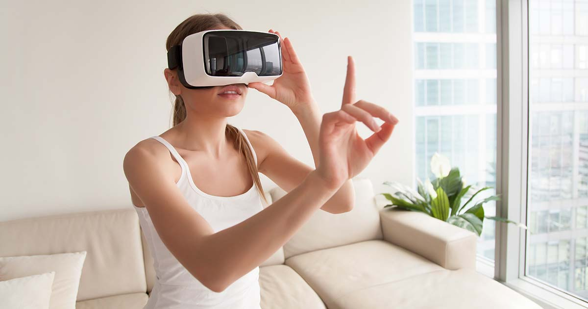 Woman in vr headset touching virtual objects